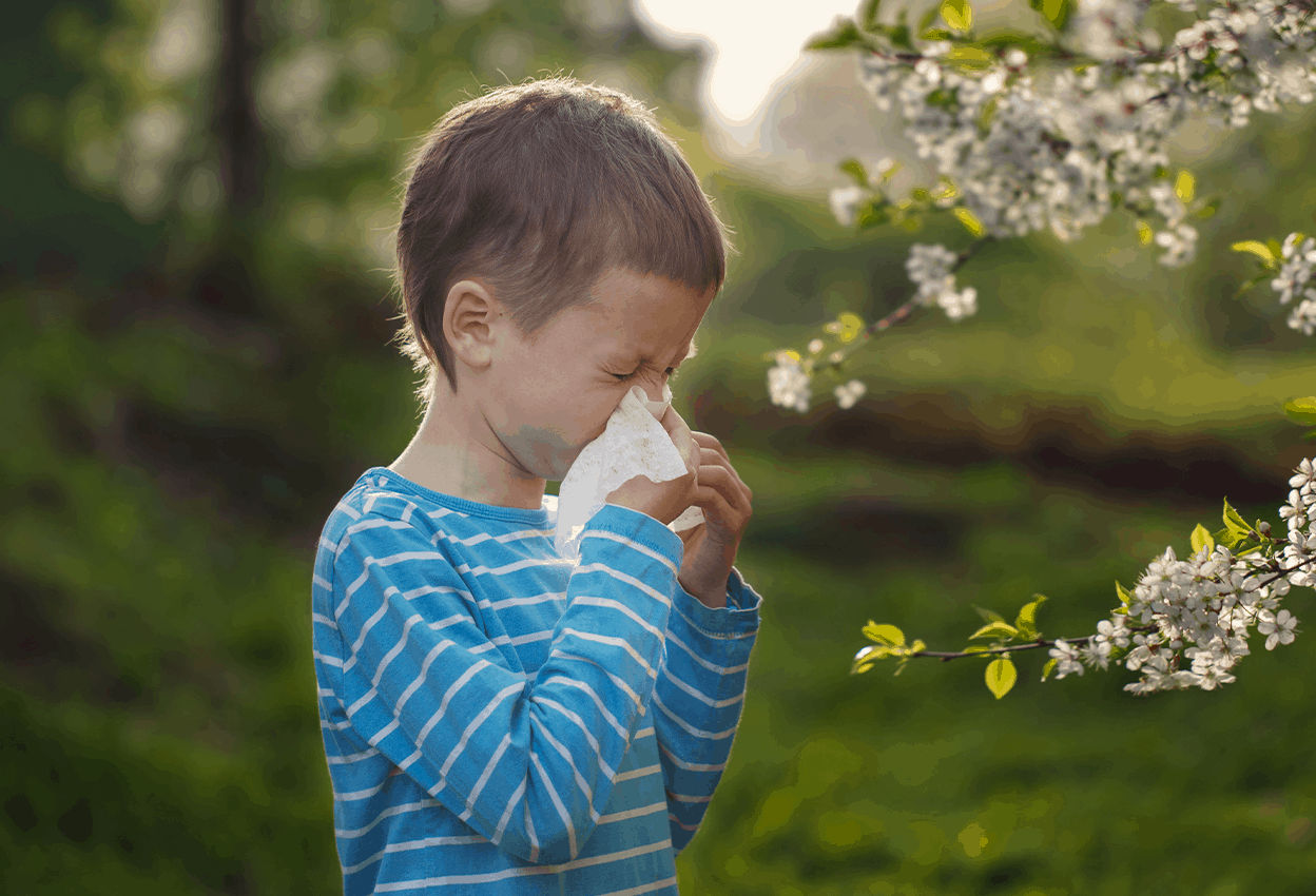 Child playing outside that can be treated using oral immunotherapy.