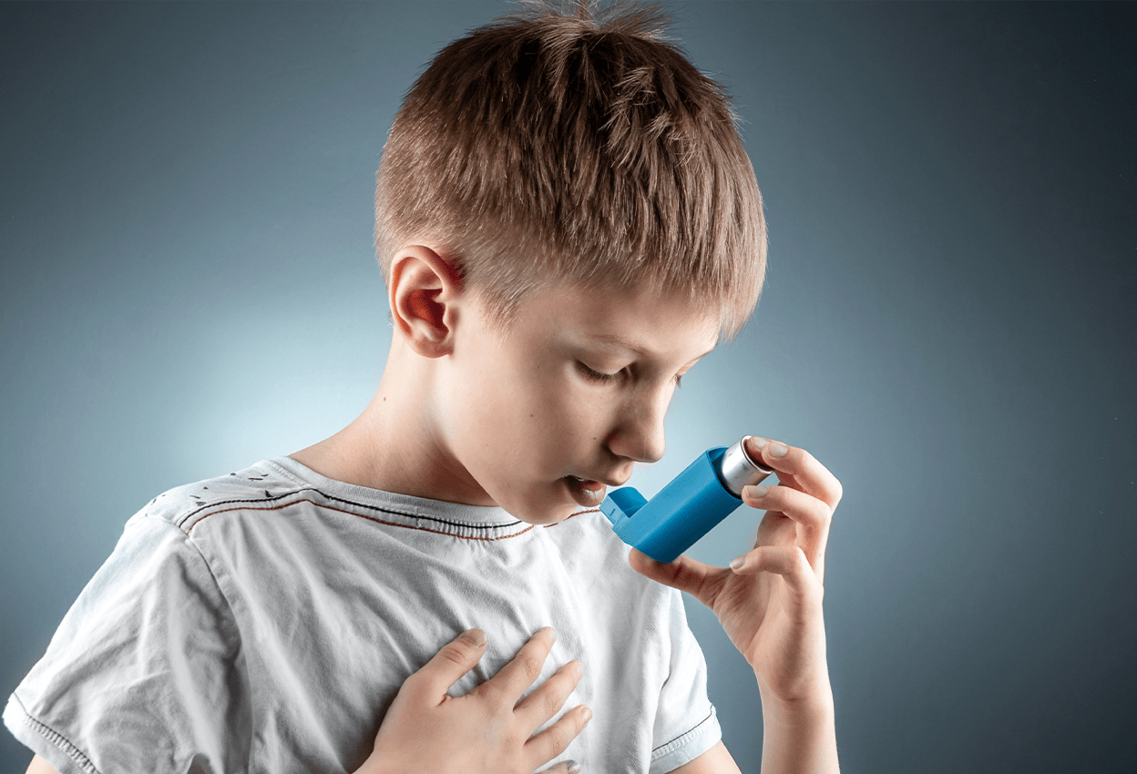 Child using inhaler at Adult and Children Allergy and Asthma Center in Pasadena, CA.